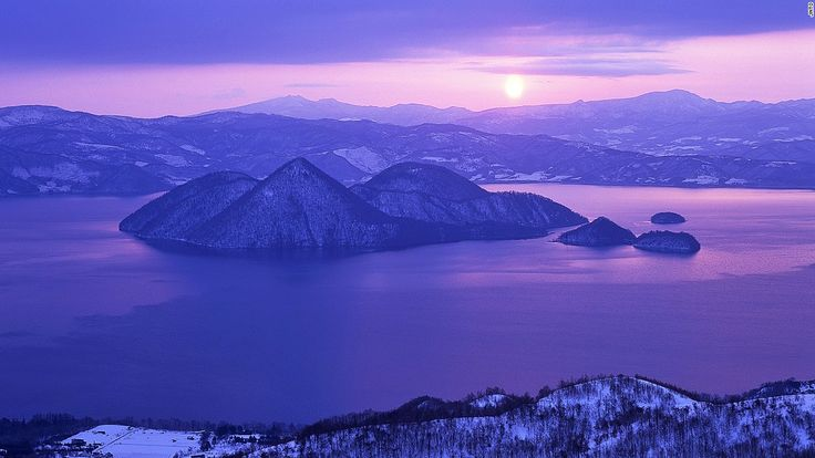 "Even in winters that plummet well below freezing point, Lake Toya never ices over. <br />The near-circular lake is the remains of a volcanic eruption that hollowed out the ground. <br />Mount Usu lies on the southern rim of the lake and Nakajima Island sits at the center.<em><br /><a href=""http://www.toyako-vc.jp/en/"" target=""_blank"">Shikotsu-Toya National Park</em></a><em>, Toyako, Hokkaido, Japan; +81 142 75 2555</em&gt..."