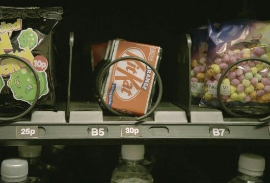 """I banged my hand on the vending machine. My KitKat wouldn't fall down. It was rather frustrating. I glanced around for any witnesses. Then I punched in a series of numbers. The vending machine beeped loudly for a moment before every single item in the front fell into the retrieval hatch. I smirked. """"Are you going to share that?"""" A low voice spoke very close to my ear. I jumped. Whirling around I turned to see the speaker. Smirking with a knowing look in his eye was Alexander Wolfe."""