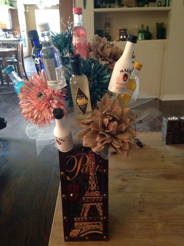 Mini alcohol bouquet my best friend made me for my 21st birthday! It's a wine bottle holder with burlap flowers! Take out the alcohol and it goes perfectly in my room! ❤️