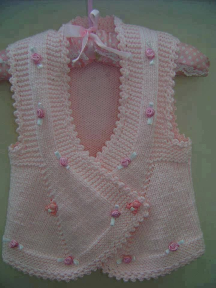 "Baby vest (which I've seen called ""Turkish Tabard""). At first sight I thought this little vest was seamless, but the sides are seamed from underarm to hem. Worked in one long piece, either back-to-front, or front-to-back ~ Pembe örgü kız çocuk yelek"
