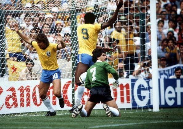 #OnThisDay 1982, #Brazil v #Argentina   #Zico (10) score his side's first goal past goalie #UbaldoFillol as #Serginho celebrates in the net.