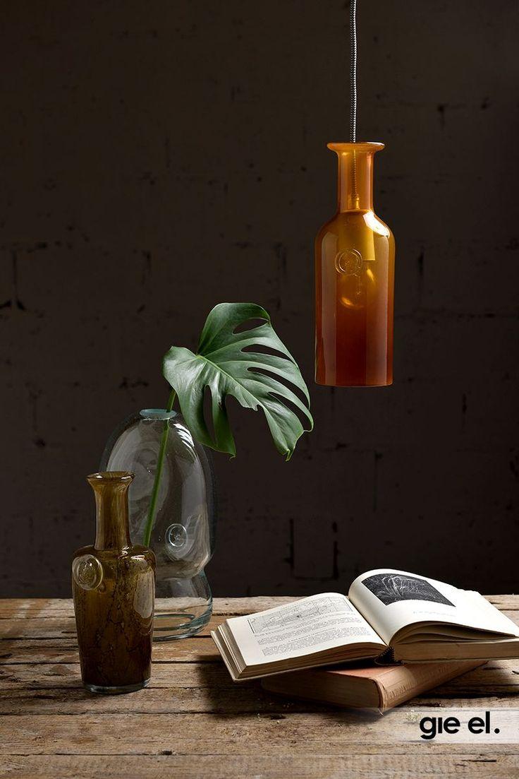 Beautiful glass pendant lamp in honey colour. Gie El Home