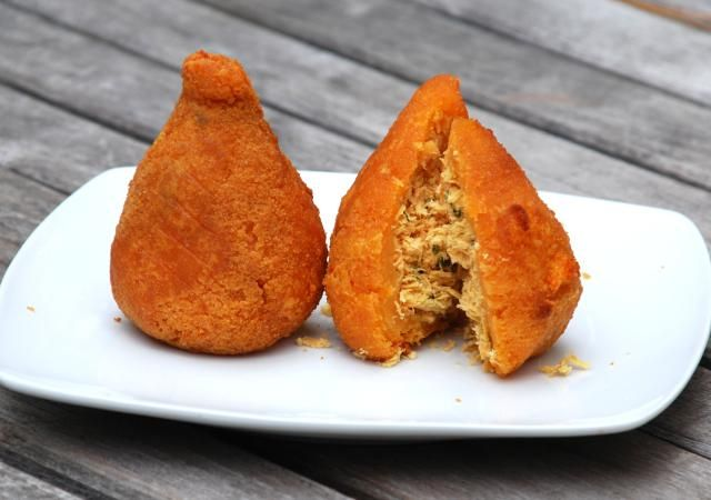Coxinhas are delicious fried chicken croquettes - a popular street food in Brazil.