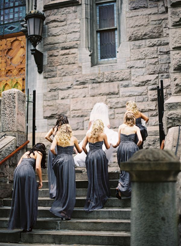 Elegant Ivy & Aster charcoal floor length bridesmaid dresses.  Photo by Bryce Covey.
