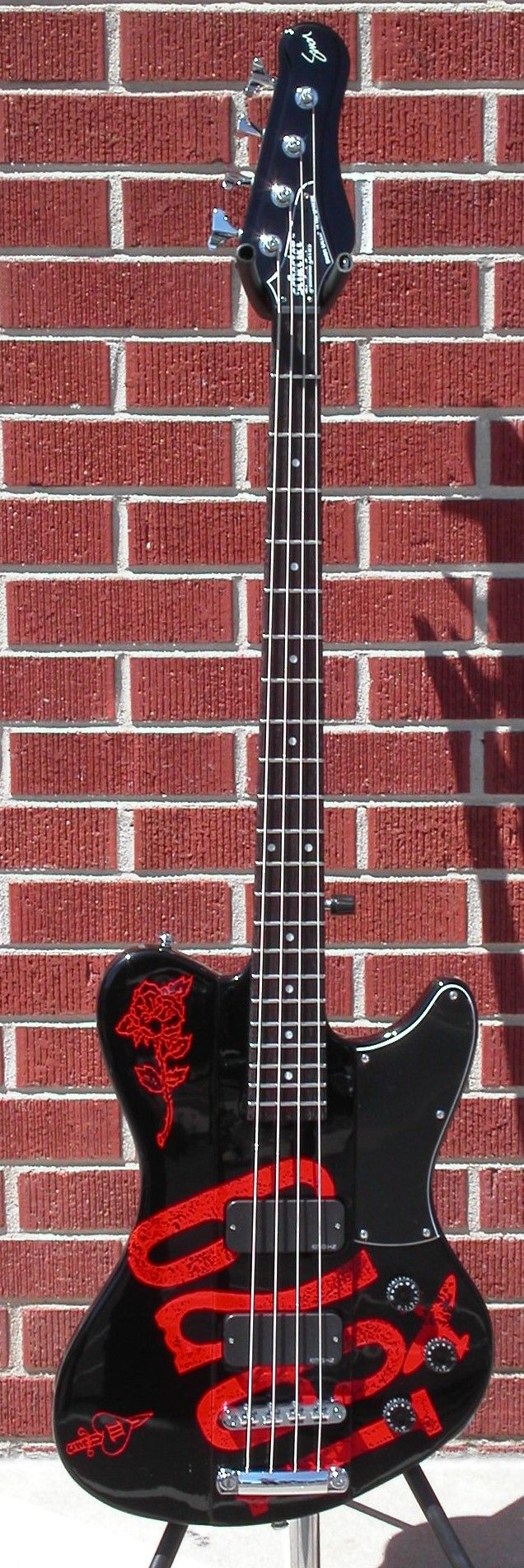 Schecter DIAMOND SERIES Simon Gallup/The Cure Ultra Spitfire Gloss Black w/Red Graphic 4-String Electric Bass Guitar