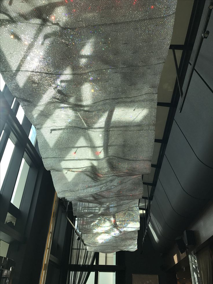 Photo 3: Crystal mesh ceiling installation in Crown. This crystal installation is a real eye catcher! In the light of day the crystal glisten clear and bright but at night with the led lights above it, it becomes an array of colour and electricity.