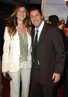 Adam Sandler and Jackie Sandler...why can't Adam wear clothes that fit?
