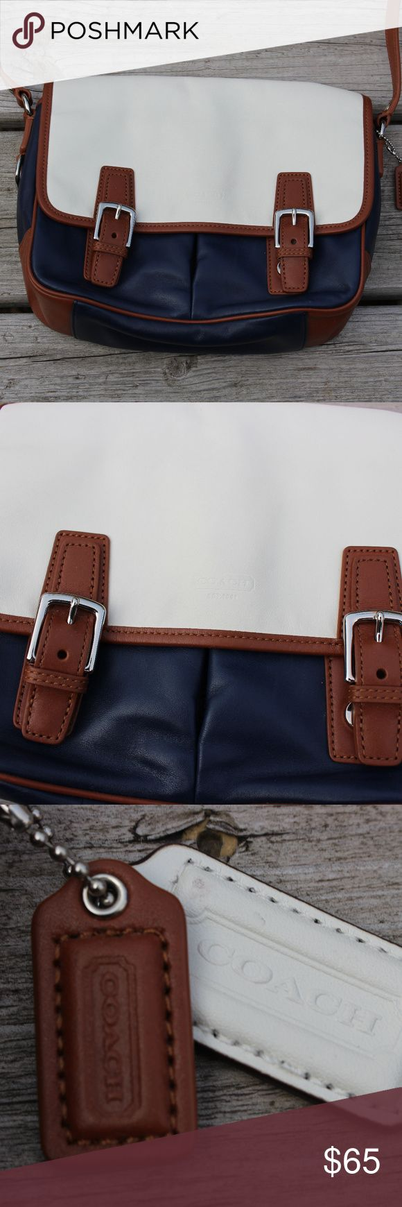 """COACH Navy Blue and White Saddle Bag Blue, brown, and white leather COACH purse. Serial number is F23383.. Strap is 46"""" and the bag is 7"""" by 11"""" Coach Bags Crossbody Bags"""