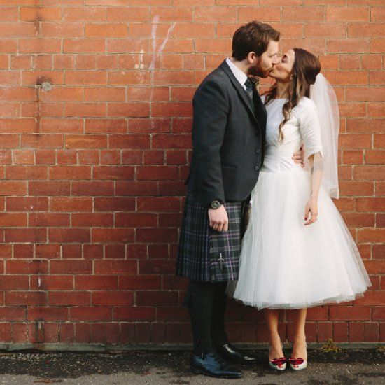 A stylish bride & Groom in tartan kilts and an Audrey Hepburn inspired bespoke wedding dress teamed with Vivienne Westwood shoes!