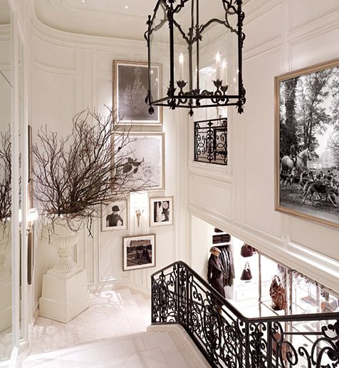 Beautiful molding, railings and light fixture! Just be careful the willow branches don't attack people using the stairs! LOL!