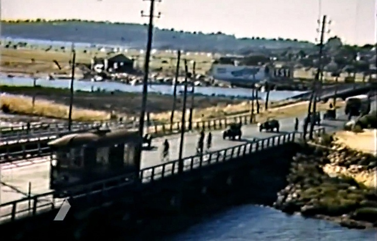 Perth Causeway looking north, with tram, bicycles and cars crossing, c1930s. From film footage.