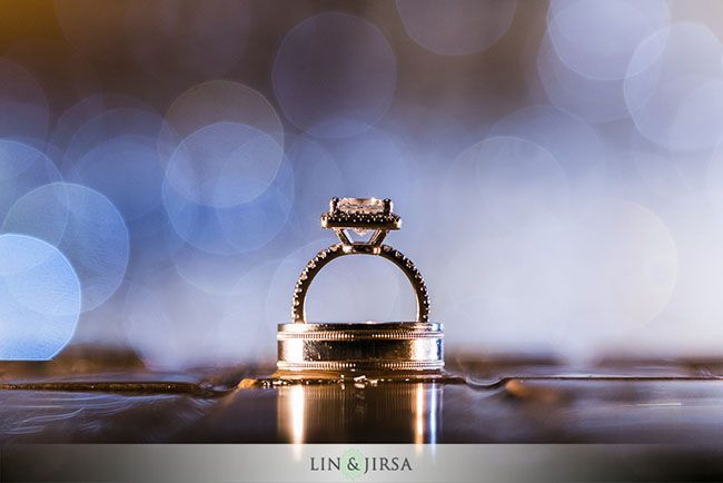 putty holds ring up  01-fairmont-newport-beach-wedding-photographer by Lin and Jirsa