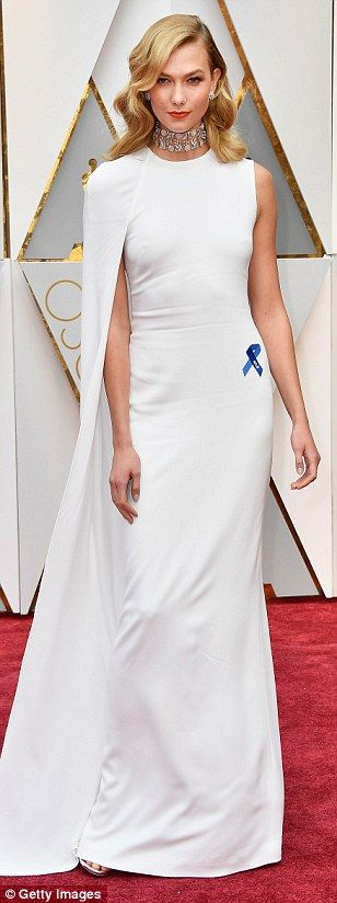 Model act:On her lapel, Karlie Kloss wore a blue ribbon in honour of the American Civil Liberties Union, commonly known as the ACLU; many stars incorporated the symbol into their outfit