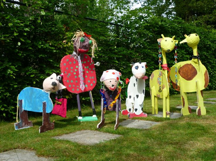 Paper mache and cardboard animals en people by 6 to 12 year old students.