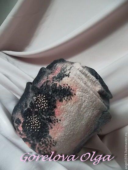 Купить или заказать Шапочка валяная'Магия' в интернет-магазине на Ярмарке Мастеров. Шапочка мягкой формы из итальянского мериноса. Выполнена из чёрной,серой и розоватой шерсти с вискозными и шёлковыми волокнами. Декоративная часть состоит из кружева и вышивки бисером. Внутри обработана трикотажной обтачкой. Шапочка тёплая,плотно облегает. В зимние холода согреет и украсит Вас! Хотите первыми узнавать о моих новых работах акциях и скидках?
