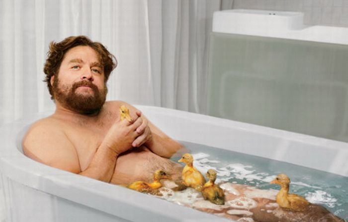Zach Galifianakis in a bathtub with ducklings | by Martin Schoeller
