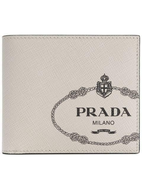 5ec2c1150dda PRADA   Logo Print Billfold Wallet   $525   Designed with a white Saffiano  leather exterior