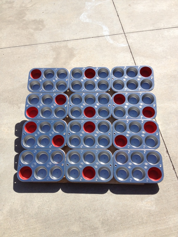 PTO carnival games. No need to rent when we can make our own. Muffin tins from the dollar store screwed to a piece of plywood with a few of the cups painted. A piece of wood was added to the bottom with a hinge to make the game stand at an angle. Less than $20 to make.