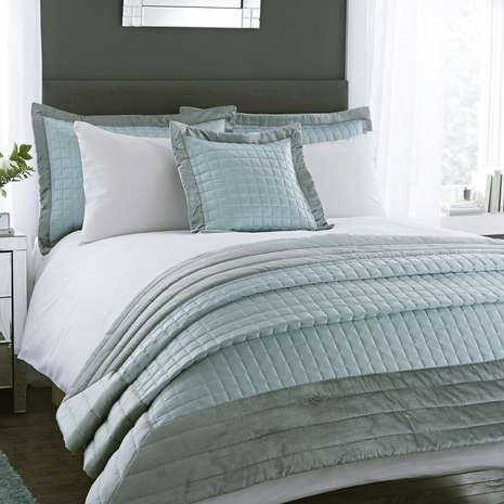 Crafted from quilted matt satin with velvet styling, this duck egg blue bedspread is generously filled with hollowfibre, offering a subtle elegant layer for your bedding.