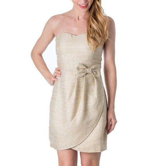 Gold & Ivory Bow Dress Sparkly & charming this bow front dress is crafted in ivory & adorned with metallic gold threading. Designed with a sweetheart neckline, tulip skirt & built-in bra, this dress is perfect for rehearsal dinners & bridal showers! Dresses Strapless