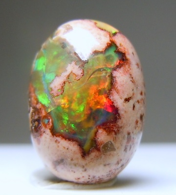 Opal is a stone of sympathy and compassion, pure thoughts & confidence. It is the most unpredictable stone, a symbol of ever-changing fortune. According to legend an opal talisman boosts foresight & is best worn on the right index finger. As an amulet it works best when in a trinket.