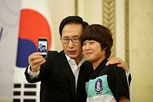 Former South Korean President Lee Myung-Bak and footballer Ji So Yun