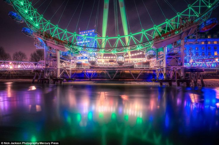 Neon glow: The London Eye was illuminated green to celebrate St Patrick's Day, and the moment was captured in this vibrant image