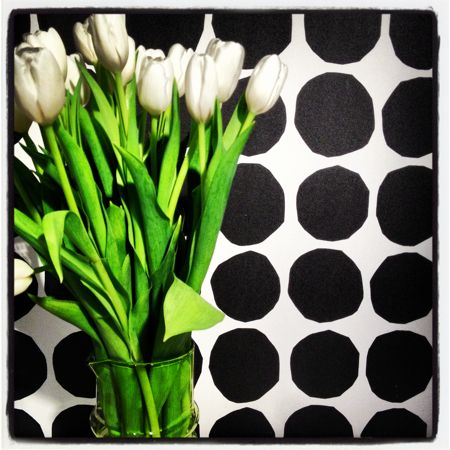 Tulips against Marimekko fabric