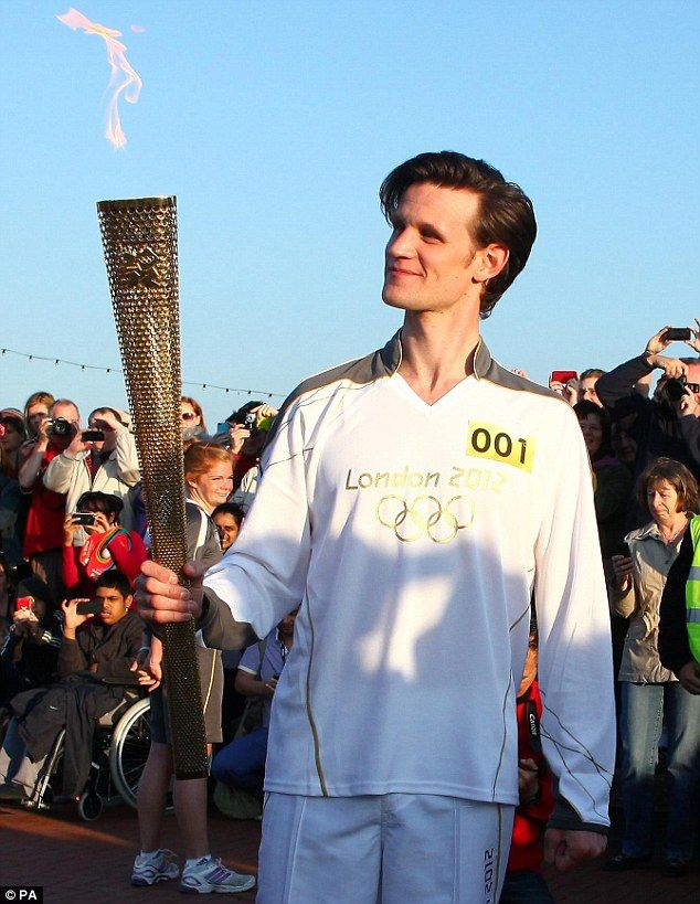 The Doctor carries the 2012 London Olympics torch. The universe is as it should be :)