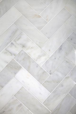 Try This Herringbone Marble Tile A Beautiful Mess Bathroom Splashbackcarrara Marble Bathroomsplashback Ideastile Bathroom Floorsbathroom