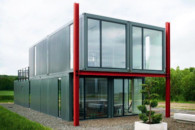 koma modular 39 s live work store in l neburg germany is made from recycled shipping containers. Black Bedroom Furniture Sets. Home Design Ideas