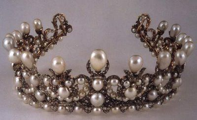 """.Empress Eugenie had this Pearl parure made for her wedding to Napoleon III. She had the jewelers take the napoléonique pearls which were from the vast """"order of the Pearls"""" of which an original parure was made for Marie~Louise. This parure had been broken up many years bears prior and Eugenie took the exact same Pearls to make her wedding jewels. Eugenie was a well documented lover of Pearls and can be seen wearing her new set in the portrait. In 1992 the """"Amis de Louvre"""" purchased the…"""
