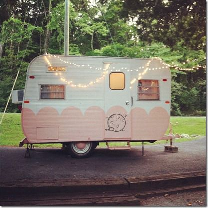 Cute vintage camper.  Love the paint job.