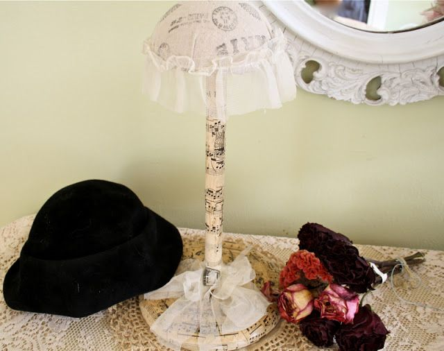 The Polka Dot Closet: Making a hat stand out of a paper towel holder