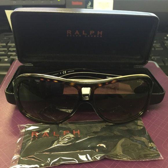 100% Authentic Ralp Lauren Sunglasses Dark brown.There's a small scratch on the side of inside of lens not noticeable.  The frame are made of special designed materials to guarantee lightness, comfort and at the same time, mechanical sturdiness. Comes with case and brand new lenses cloths. Ralph Lauren Accessories Sunglasses