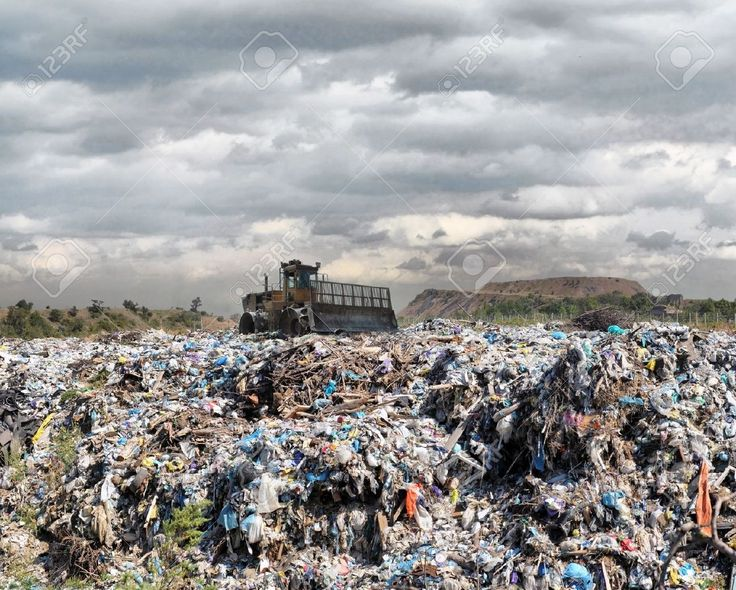 Bulldozer Buries Food And Industrial Wastes Stock Photo, Picture ...