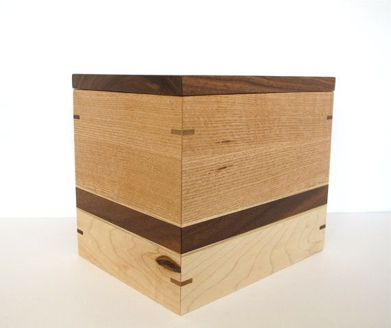 Simple and elegant wooden urn made of oak, black walnut, maple, ash and birch.