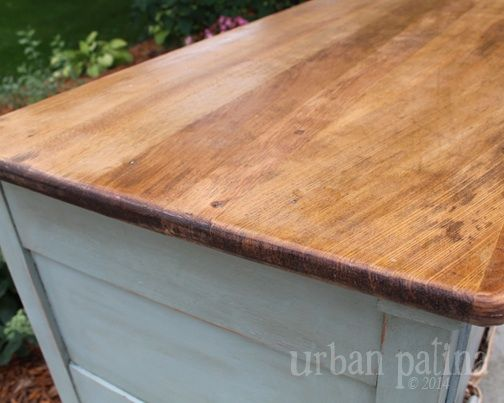 Misfit Dresser Makeover :: After I gave the top a light sanding I used Minwax Tung Oil to give the wood a natural look and feel, while protecting and highlighting the beautiful wood grain. You can pick up Tung oil at most hardware stores, I picked mine up at Home Depot.