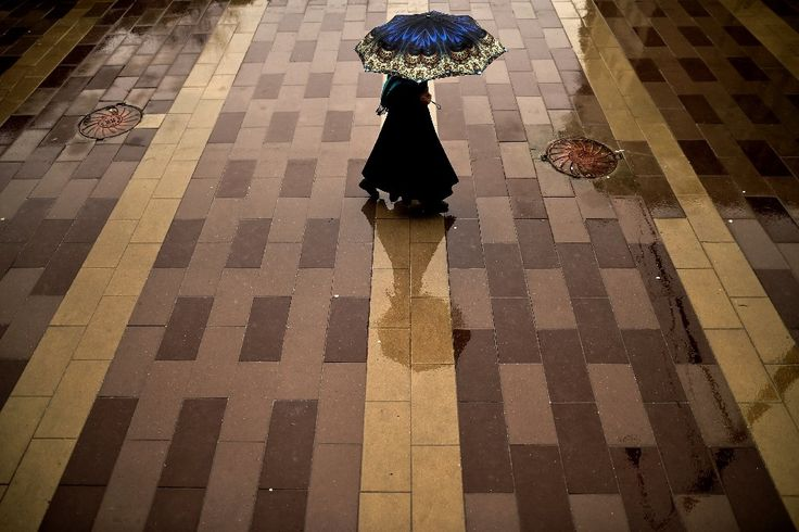 A woman with an umbrella walks in central Moscow, during rainy winter weather with temperatures at plus one degree CelsiusA woman with an umbrell...