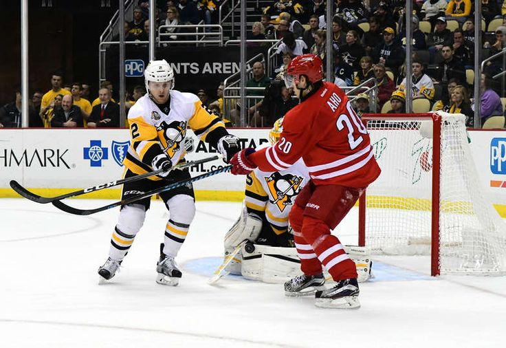 Penguins vs. Hurricanes - 12/28/2016 - Pittsburgh Penguins - Photos Chad Ruhwedel #2 of the Pittsburgh Penguins and Sebastian Aho #20 the Carolina Hurricanes