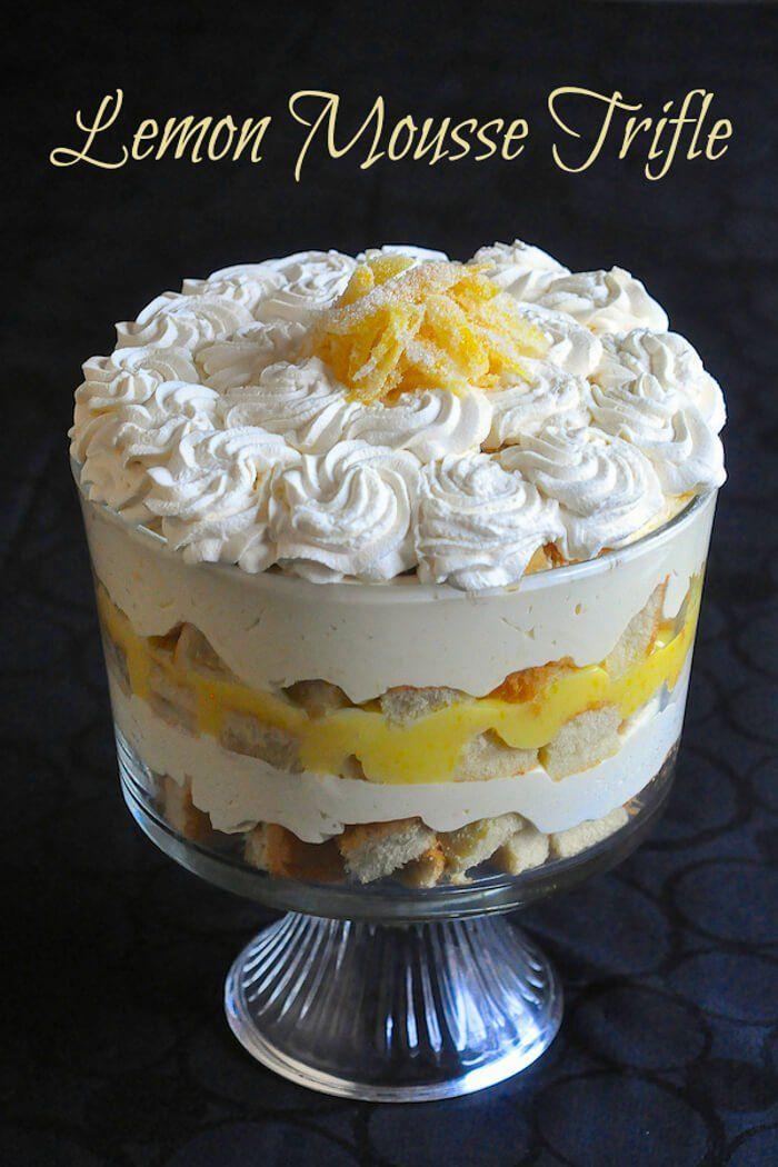 Lemon Mousse Trifle - a lemon lovers dream! It's a simple but delicious combination of sponge cake, lemon mousse, limoncello liqueur and whipped cream.