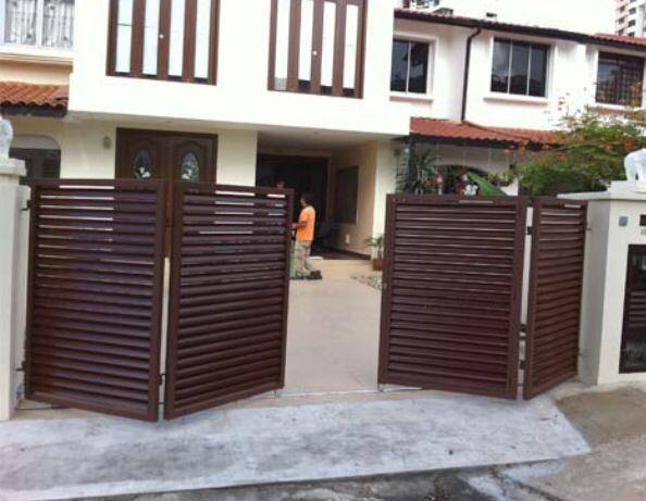 Modern bifold driveway gate.  Bi-folding