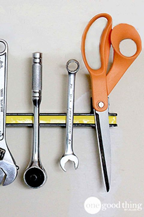 Use wall-mount kitchen knife magnets to hang metal tools or to dry and store paintbrushes.        Get more ideas at One Good Thing By Jillee.