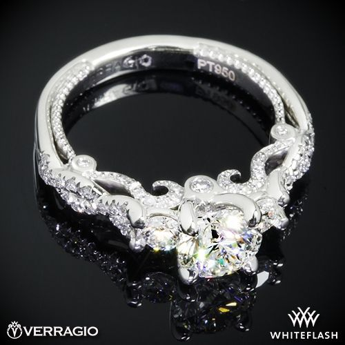 This 3 Stone Engagement Ring is from the Verragio Insignia Collection. It features 0.50ctw (F/G VS) round brilliant cut diamond melee to enhance a round diamond center of your choice. The width tapers from 2.7mm at the top down to 2.2mm at the bottom.