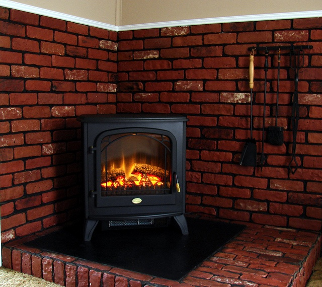 What a stunning setting for the #Dimplex Traditional Freestanding Electric Stove - See More customer installs: http://www.electricfireplacesdirect.com/blog/Real-Customer-Installs-Spotlight?utm_source=pinterest&utm_medium=social&utm_campaign=customerinstall