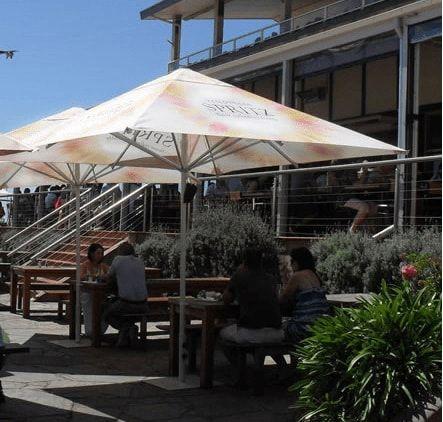 Printed market umbrellas for a cafe.