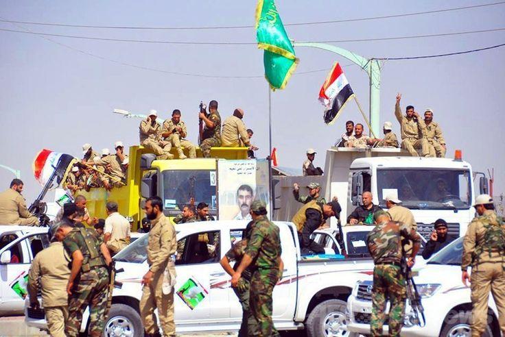 イラクの首都バグダッド(Baghdad)の北にあるイスラム教スンニ(Sunni)派の都市サマラ(Samarra)に到着した政府軍部隊と主にシーア派からなる志願兵ら(2014年7月2日撮影)。(c)AFP ▼3Jul2014AFP|イラク首相、反政府派の大赦を発表 政情打開狙い http://www.afpbb.com/articles/-/3019534 #Samarra