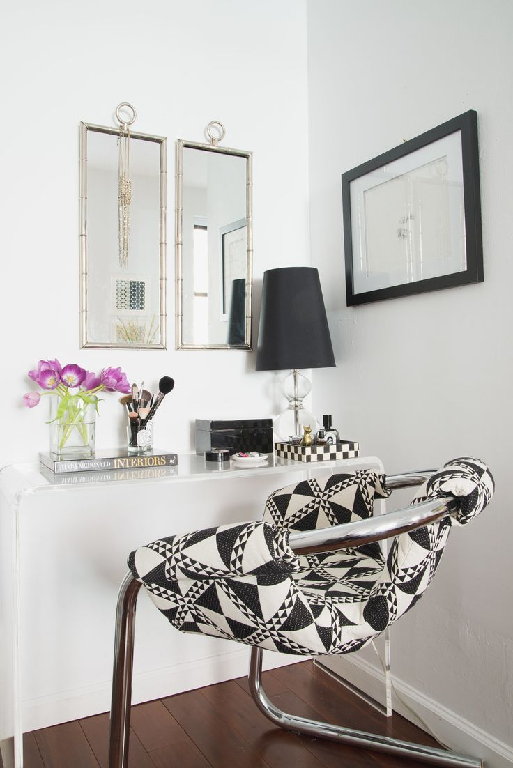 Julia's desk area keeps with the minimalist theme, employing primarily black and white.