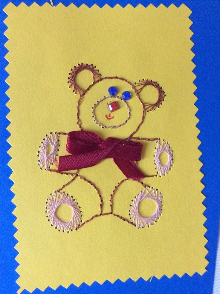 Blue-eyed teddy with bowtie