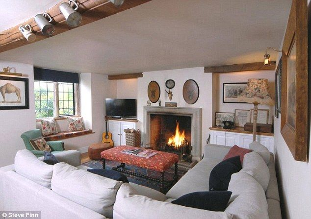 Rustic feel: The quaint cottage boasts original period features like exposed beams and low...